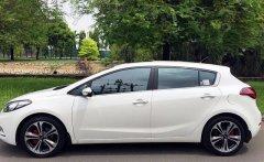 Bán xe Kia K3 AT đời 2014, màu trắng, nhập khẩu nguyên chiếc giá 665 triệu tại Tp.HCM