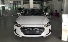 Bán Hyundai Elantra 1.6L MT màu trắng với giá cực tốt, hỗ trợ đăng kí Grab miễn phí giá 560 triệu tại Tp.HCM