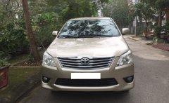 Gia đình cần bán chiếc xe ô tô Toyota Innova 2.0E màu ghi vàng, SX 2013 giá 415 triệu tại Hà Nội